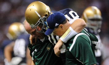 Notre Dame Fighting Irish Quarterback Dayne Crist (#10) is helped off the field after injuring his knee against Washington State at the Alamodome in San Antonio, Tx. (Photo - IconSMI)