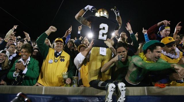 Notre Dame Fighting Irish cornerback Bennett Jackson (2) jumps into the stands to celebrate with the fans after the game against the Michigan Wolverines at Notre Dame Stadium. Notre Dame defeats Michigan 13-6. (Photo - Brian Spurlock / US PRESSWIRE)
