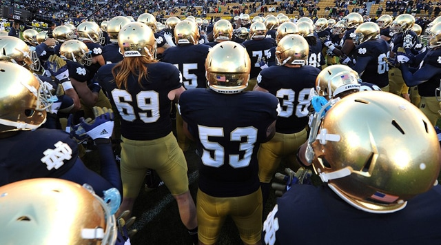 Notre Dame huddles at the center field prior to an NCAA football game between the Michigan Wolverines and the Notre Dame Fighting Irish at Notre Dame Stadium in Notre Dame, IN (Photo - Chris Williams / Icon SMI)