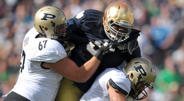 Notre Dame, IN:  Purdue Boilermakers quarterback Robert Marve (9) is sacked by Notre Dame Fighting Irish nose guard Louis Nix (9) as Boilermakers offensive guard Peters Drey (67) defends in the second quarter at Notre Dame Stadium. (Photo - Matt Cashore-US PRESSWIRE)