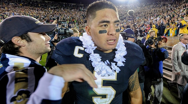 Notre Dame Fighting Irish linebacker Manti Te'o (5) wears a traditional Hawaiian Leis after the game, to honor the passing of his late grand mother and girlfriend. The Notre Dame Fighting Irish defeated the Michigan Wolverines by the score of 13-06, at Notre Dame Stadium, in South Bend, IN.  (Photo - Robin Alam/Icon SMI)
