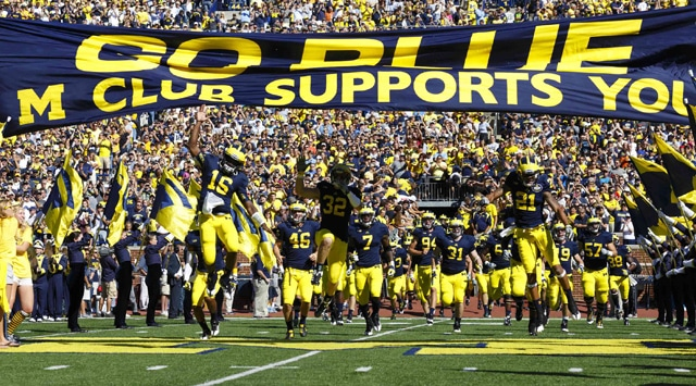 Michigan Wolverines quarterback Denard Robinson (16), safety Jordan Kovacs (32) and wide receiver Roy Roundtree (21) lead out the team before the game against the Massachusetts Minutemen at Michigan Stadium. (Photo - Rick Osentoski-US PRESSWIRE)