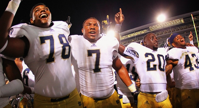 East Lansing, MI, USA; Notre Dame Fighting Irish offensive linesman Ronnie Stanley (78), defensive end Stephon Tuitt (7), and running back Cierre Wood (20) celebrate after their win at Spartan Stadium. Norte Dame won 20-3. (Photo - Mike Carter-US PRESSWIRE)