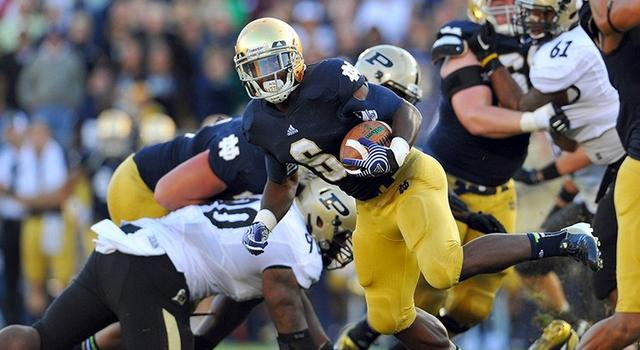 Notre Dame Fighting Irish running back Theo Riddick (6) runs the ball in the fourth quarter against the Purdue Boilermakers at Notre Dame Stadium. Notre Dame won 20-17. (Photo - Matt Cashore / US PRESSWIRE)