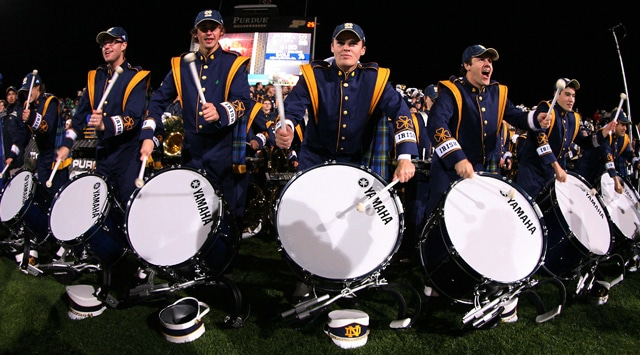 Before the band, and the drum line, perform on Saturdays (shown above), they put on a show for fans in front of the Golden Dome at midnight on the eve of kickoff.  (Photo - Brian Spurlock / US PRESSWIRE )
