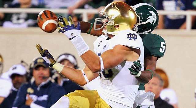 Notre Dame Fighting Irish tight end Tyler Eifert (80) makes a catch as Michigan State Spartans cornerback Johnny Adams (5) defends during second half of the game at Spartan Stadium. Notre Dame won 20-3. (Photo - Mike Carter / US PRESSWIRE)