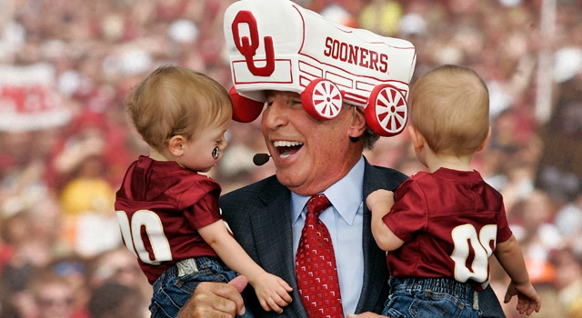 Wearing an Oklahoma Sooners hat, ESPN's College GameDay football analyst Lee Corso reacts to his grandsons, who are wearing Florida State shirts, prior to the start of the Florida State Seminoles college football game against the Oklahoma Sooners at Doak Campbell Stadium. Corso had just predicted the Sooners would defeat the Seminoles. (Photo: Phil Sears-US PRESSWIRE)
