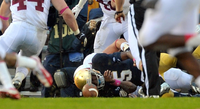 Notre Dame Fighting Irish quarterback Everett Golson (5) fumbles the ball in the end zone as Stanford Cardinal linebacker Chase Thomas (44) moves in to recover the fumble. Thomas recovered the ball in the end zone for a Stanford touchdown in the second quarter at Notre Dame Stadium. (Photo: Matt Cashore / US PRESSWIRE)
