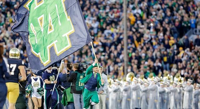22 September, 2012: The Notre Dame leprechaun runs onto the field with the Notre Dame Fighting Irish flag in game action. The Notre Dame Fighting Irish defeated the Michigan Wolverines by the score of 13-6, at Notre Dame Stadium, in South Bend, IN.