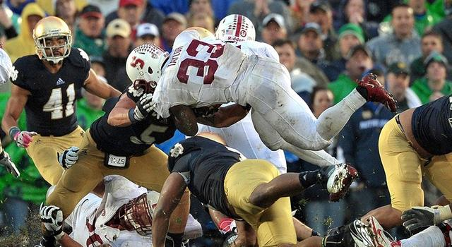Oct. 13, 2012; South Bend, IN, USA; Stanford Cardinal running back Stepfan Taylor (33) runs the ball as Notre Dame Fighting Irish linebacker Manti Te'o (5) defends in the fourth quarter at Notre Dame Stadium. Notre Dame won 20-13 in overtime. Mandatory Credit: Matt Cashore-US PRESSWIRE