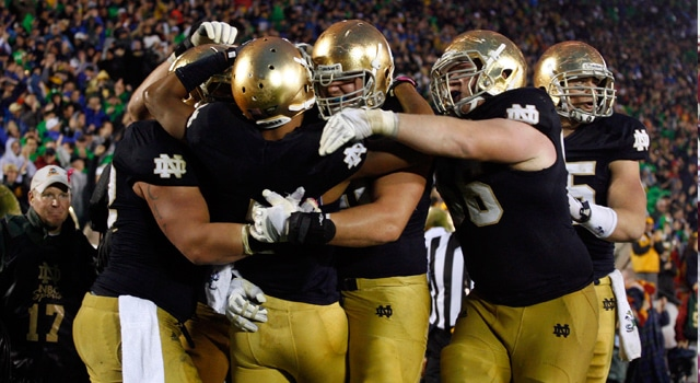 Notre Dame Fighting Irish wide receiver T.J. Jones (7) is congratulated by teammates after scoring the winning touchdown against the Stanford Cardinal at Notre Dame Stadium. Notre Dame defeats Stanford in overtime 20-13. (Photo: Brian Spurlock-US PRESSWIRE)