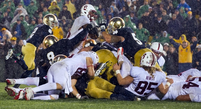 Stanford Cardinal running back Stepfan Taylor (33) attempts to dive over the goal line as Notre Dame Fighting Irish nose guard Louis Nix (9) and linebacker Manti Te'o (5) defend in overtime at Notre Dame Stadium. Notre Dame won 20-13. Photo: Matt Cashore / US PRESSWIRE)