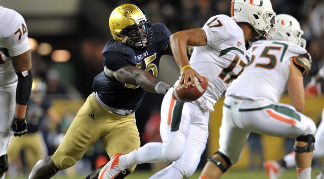 Notre Dame Fighting Irish linebacker Prince Shembo (55) pressures Miami Hurricanes quarterback Stephen Morris (17) in the third quarter at Soldier Field. Notre Dame won 41-3. (Photo: Matt Cashore / US PRESSWIRE)