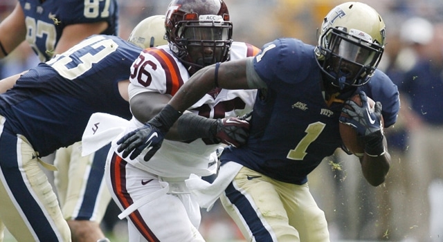 Pittsburgh Panthers running back Ray Graham (1) carries the ball against Virginia Tech Hokies defensive end Corey Marshall (96) during the fourth quarter at Heinz Field. The Pittsburgh Panthers won 35-17. (Photo: Charles LeClaire / US PRESSWIRE)