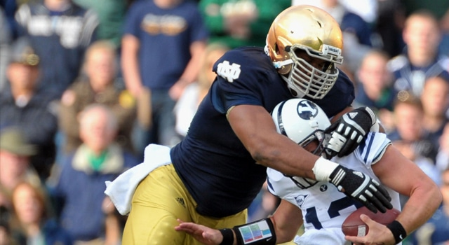 Notre Dame Fighting Irish defensive end Stephon Tuitt (7) sacks BYU Cougars quarterback Riley Nelson (13) during the first quarter at Notre Dame Stadium. Notre Dame won 17-14. (Photo: Matt Cashore / US PRESSWIRE)