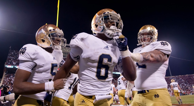 Notre Dame Fighting Irish running back Theo Riddick (6) celebrates with quarterback Everett Golson (5) and center Braxston Cave (52) after a touchdown in the fourth quarter against the Oklahoma Sooners at Oklahoma Memorial Stadium. Notre Dame won 30-13. (Photo: Matt Cashore / US PRESSWIRE)
