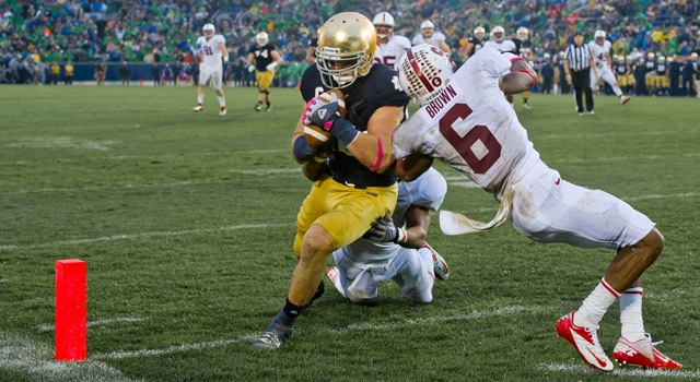 Notre Dame Fighting Irish tight end Tyler Eifert (80) catches a touchdown pass as Stanford Cardinal cornerback Terrence Brown (6) defends in the fourth quarter at Notre Dame Stadium. Notre Dame won 20-13 in overtime. (Photo: Matt Cashore-US PRESSWIRE)