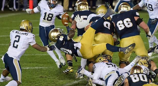 Nov. 3, 2012; South Bend, IN, USA; Notre Dame Fighting Irish running back Cierre Wood (20) fumbles the ball as he dives across the goal line in the second overtime against the Pittsburgh Panthers at Notre Dame Stadium. Notre Dame won 29-26 in triple overtime. Mandatory Credit: Matt Cashore-US PRESSWIRE