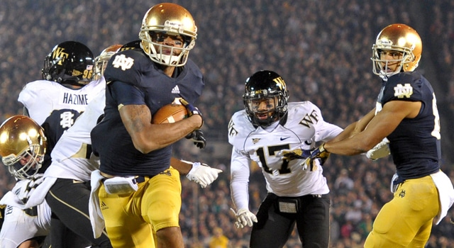 Notre Dame Fighting Irish running back George Atkinson III (4) runs into the end zone for a touchdown in the third quarter against the Wake Forest Demon Deacons at Notre Dame Stadium. Notre Dame won 38-0. Mandatory Credit: Matt Cashore-US PRESSWIRE