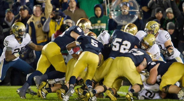 Notre Dame Fighting Irish quarterback Everett Golson (5) scores the game winning touchdown against the Pittsburgh Panthers in the third overtime at Notre Dame Stadium. Notre Dame won 29-26. (Photo: Matt Cashore-US PRESSWIRE)