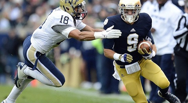 Nov 03, 2012; South Bend, IN, USA; Notre Dame Fighting Irish wide receiver Robby Toma (9) makes a catch against Pittsburgh Panthers defensive back Jarred Holley (18) during the first half at Notre Dame Stadium. Mandatory Credit: Mike DiNovo-US PRESSWIRE