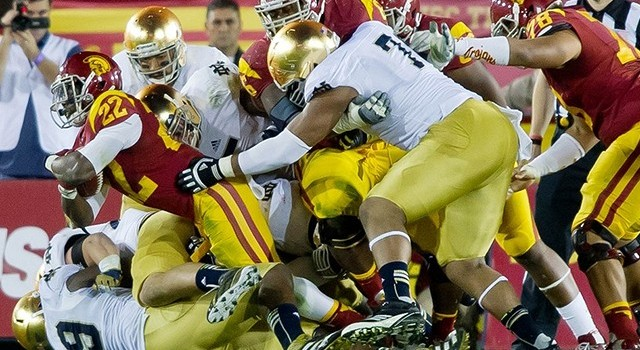 Nov. 24, 2012; Los Angeles, CA, USA; USC Trojans tailback Curtis McNeal (22) is tackled by Notre Dame Fighting Irish defensive end Kapron Lewis-Moore (89) and defensive end Stephon Tuitt (7) in the fourth quarter at the Los Angeles Memorial Coliseum. Notre Dame won 22-13. Mandatory Credit: Matt Cashore-US PRESSWIRE