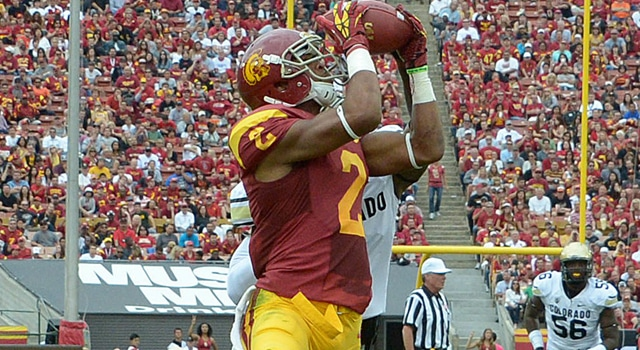 Southern California Trojans receiver Robert Woods (2) scores on a 29-yard touchdown pass in the second quarter against the Colorado Buffaloes at the Los Angeles Memorial Coliseum. Mandatory Credit: Kirby Lee/Image of Sport-US PRESSWIRE