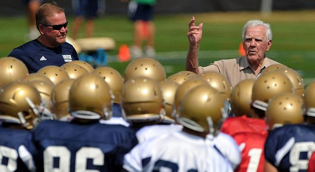 Aug. 19, 2010; South Bend, IN, USA; Notre Dame Fighting Irish head coach Brian Kelly (left) listens as former Notre Dame coach Ara Parseghian (right) talks to the team during practice at the LaBar Practice Complex. Mandatory Credit: Matt Cashore-USA TODAY Sports