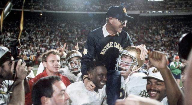 Jan 1, 1990; Miami, FL, USA; FILE PHOTO; Notre Dame Irish head coach Lou Holtz is carried off the field following their victory over Colorado winning the 1989 National Championship at the Orange Bowl. Mandatory Credit: Photo By USA TODAY Sports © Copyright USA TODAY Sports