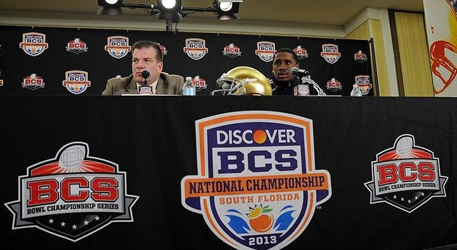 Jan 4, 2013; Fort Lauderdale FL, USA; quarterback Everett Golson (right) and offensive coordinator Chuck Martin (left) during a press conference for the 2013 BCS National Championship game at Harbor Beach Marriott Resort & Spa. Mandatory Credit: Steve Mitchell-USA TODAY Sports