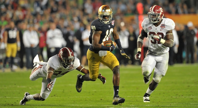 Notre Dame Fighting Irish wide receiver DaVaris Daniels (10) carries the ball past Alabama Crimson Tide defensive back Geno Smith (24) and C.J. Mosley (32) during the second half of the 2013 BCS Championship game at Sun Life Stadium. (Photo - Matt Cashore / USA TODAY Sports)