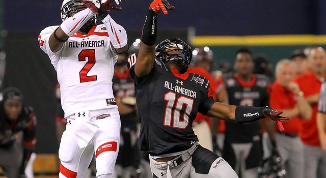 Tarean Folston (10) knocks the ball away from Robbie Rhodes (2) during the 2013 Under Armour All-America Game between Team Highlight (Black) and Team Nitro (white) at Tropicana Field in St. Petersburg, FL.  (Photo - Cliff Welch / Icon SMI)