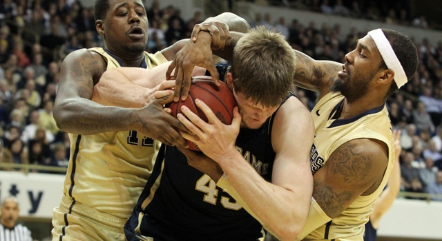 Notre Dame Fighting Irish forward Jack Cooley (45) is tied up by Pittsburgh Panthers forward Dante Taylor (left) and forward J.J. Moore (right) during the first half at the Petersen Events Center. (Photo -Charles LeClaire / USA TODAY Sports)