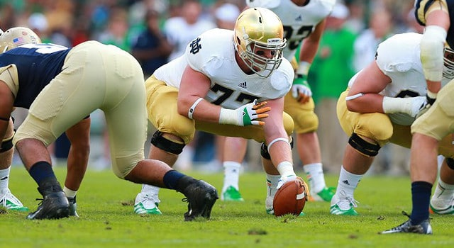 Dublin, Ireland. Notre Dame Fighting Irish center Matt Hegarty #77 prepares to snap the ball during the American Football game between Notre Dame and Navy from the Aviva Stadium. (Photo - Paul Walsh/Actionplus/Icon SMI)