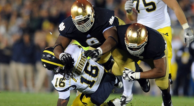 Stephon Tuitt and Louis Nix combine on a hit on former Michigan QB Denard Robnson