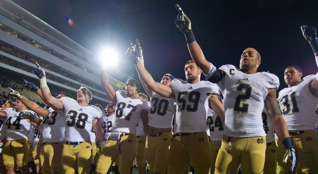 Notre Dame Fighting Irish cornerback Bennett Jackson (2) and linebacker Jarrett Grace (59) celebrate with their teammates after Notre Dame defeated the Purdue Boilermakers 31-24 at Ross-Ade Stadium. Mandatory Credit: Matt Cashore-USA TODAY Sports