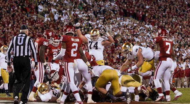 Oct. 27, 2012; Norman, OK, USA; Notre Dame Fighting Irish offensive tackle Christian Lombard (74) signals touchdown after quarterback Everett Golson (5) (not shown) scored in the fourth quarter against the Oklahoma Sooners at Oklahoma Memorial Stadium. Notre Dame won 30-13. Mandatory Credit: Matt Cashore-USA TODAY Sports