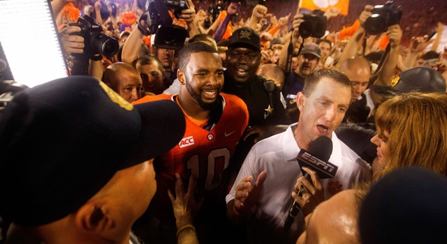 Clemson Tigers head coach Dabo Swinney (right) and Clemson Tigers quarterback Tajh Boyd (10) are rushed by media following the game against the Georgia Bulldogs at Clemson Memorial Stadium. Tigers won 38-35. Mandatory Credit: Joshua S. Kelly-USA TODAY Sports