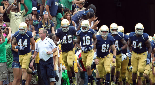 Aug 31, 2013; South Bend, IN, USA; Notre Dame coach Brian Kelly leads the team onto the field before the game against the Temple Owls at Notre Dame Stadium. Mandatory Credit: Brian Spurlock-USA TODAY Sports
