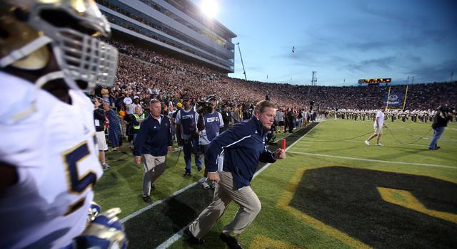 Sep 14, 2013; West Lafayette, IN, USA; Notre Dame Fighting Irish coach Brian Kelly leads his team onto the field before the game against the Purdue Boilermakers at Ross Ade Stadium. Mandatory Credit: Brian Spurlock-USA TODAY Sports