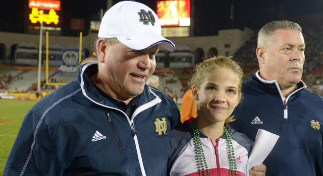 Brian Kelly (left) walks off the field with his daughter Grace Kelly after the game against the Southern California Trojans at the Los Angeles Memorial Coliseum. Notre Dame defeated USC 22-13. Mandatory Credit: Kirby Lee/Image of Sport-USA TODAY Sports