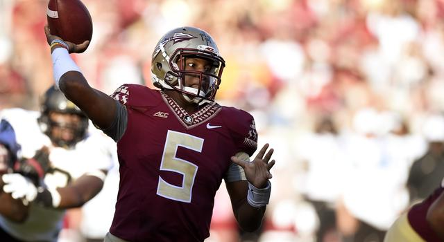 Oct 4, 2014; Tallahassee, FL, USA; Florida State Seminoles quarterback Jameis Winston (5) drops back to pass against the Wake Forest Demon Deacons during the fourth quarter at Doak Campbell Stadium. Florida State Seminoles defeated the Wake Forest Demon Deacons 43-3. Mandatory Credit: John David Mercer-USA TODAY Sports