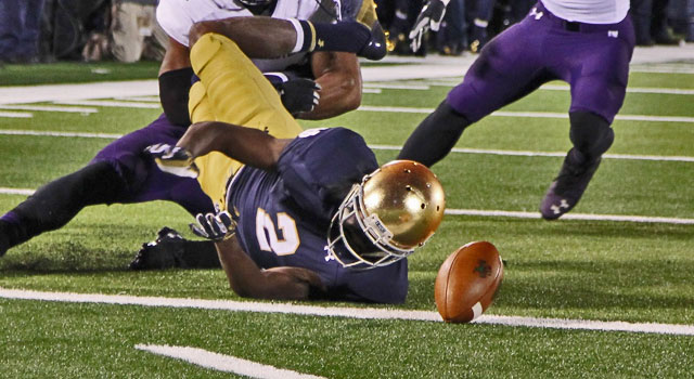 Notre Dame Fighting Irish wide receiver Chris Brown (2) fumbles the ball on the 1 yard line after being tackled by Northwestern Wildcats safety Ibraheim Campbell (24) at Notre Dame Stadium. Mandatory Credit: Brian Spurlock-USA TODAY Sports