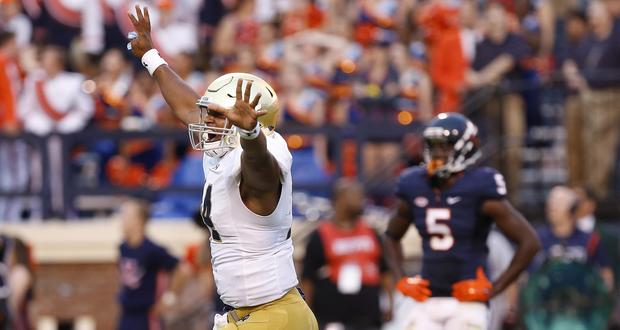 Sep 12, 2015; Charlottesville, VA, USA; Notre Dame Fighting Irish quarterback DeShone Kizer (14) celebrates after throwing the game-winning touchdown pass against the Virginia Cavaliers with twelve seconds left in the fourth quarter at Scott Stadium. The Fighting Irish won 34-27. Mandatory Credit: Geoff Burke-USA TODAY Sports
