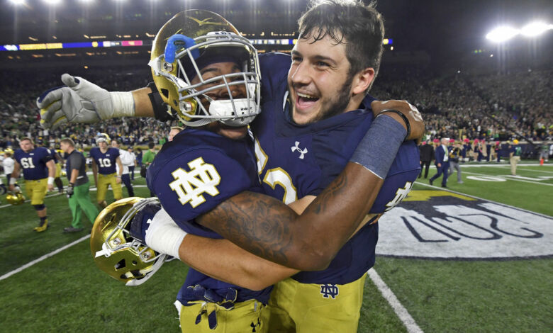 Notre Dame OL Robert Hainsey (right) celebrates with S Isaiah Robertson