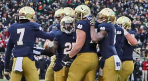 Notre Dame Fighting Irish running back Tarean Folston (25) is congratulated by teammates after scoring a touchdown against the Northwestern Wildcats at Notre Dame Stadium. Mandatory Credit: Brian Spurlock-USA TODAY Sports